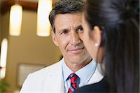 Optical Doctor Talking with Patient